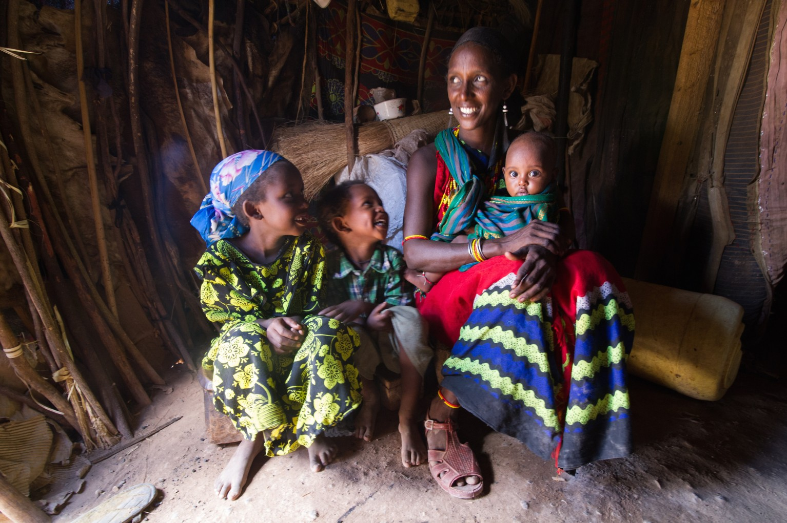 Bone Guyo pictured with three of her five children in her home.